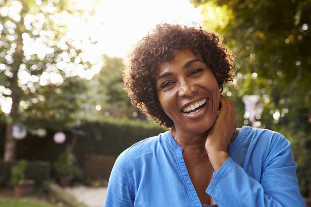 Portrait of a woman with beautiful dental implants