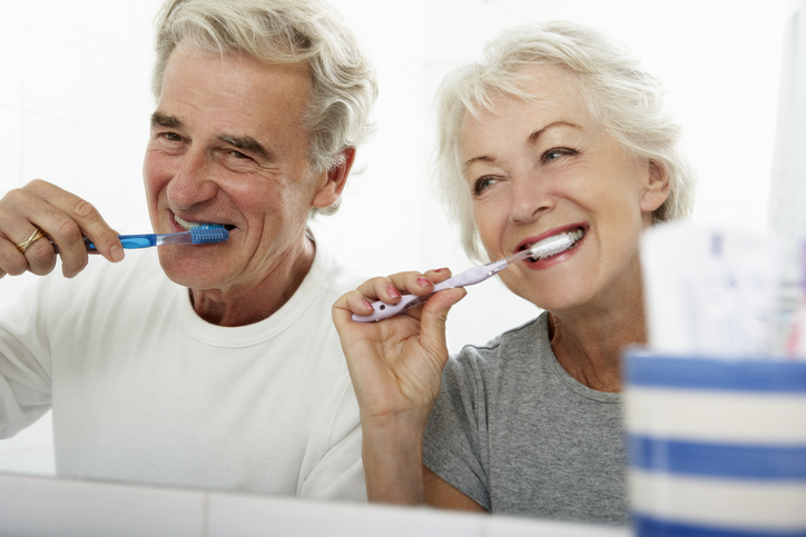 Senior Couple In Bathroom Brushing Teeth.